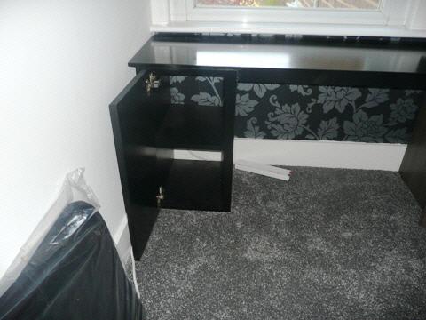 black desk and storage